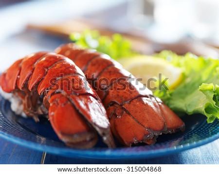 lobster dinner with lemon and lettuce garnish - stock photo