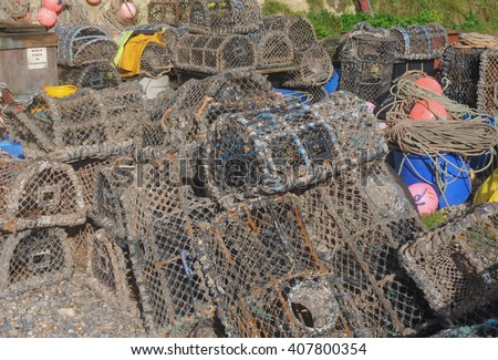Lobster Pots on the Beach at the Coastal Resort of Beer in Devon, England, UK - stock photo