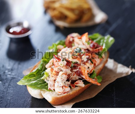 lobster roll on slate surface - stock photo