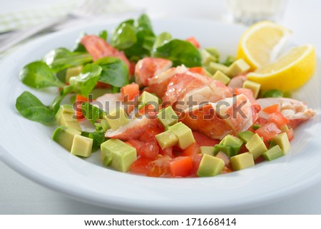Lobster salad with avocado, tomato, lettuce, and lemon