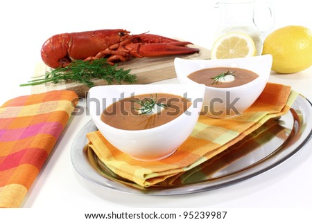 lobster soup with lemon, dill and cream dollop - stock photo