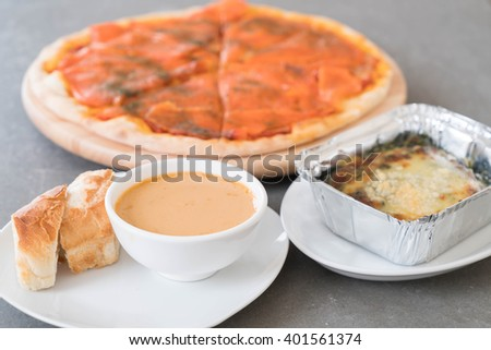 lobster soup with smoked pizza and baked spinach