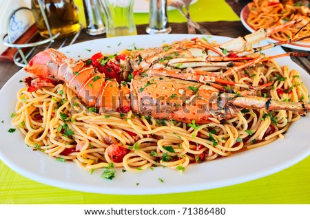 lobster spaghetti with tomato sauce - stock photo