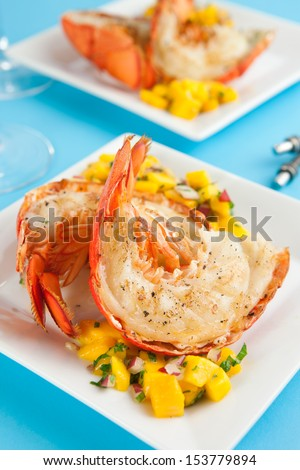 Lobster tails with mango salsa - stock photo
