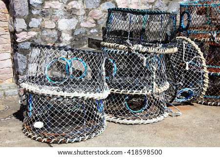 Lobster traps and crab pots at a dock in Brixham,Devon, England, UK