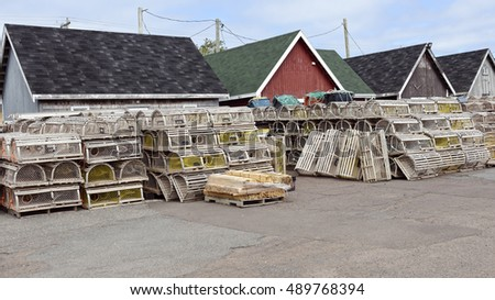 Lobster traps and wooden fishing sheds in the village of North Rustico, Prince Edward Island, Canada