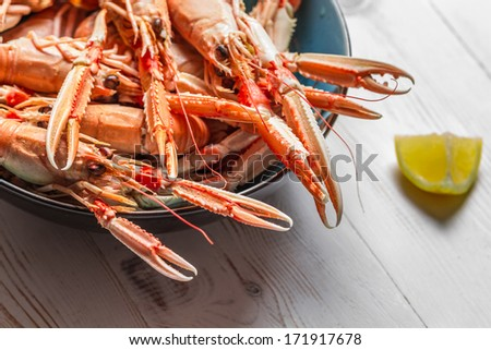 Lobster with lemon as a seafood dish - stock photo