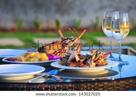 Lobster with white wine. - stock photo