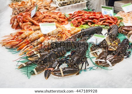 Lobsters, shrimps and prawns, fresh seafood in the fish market in Barcelona - stock photo