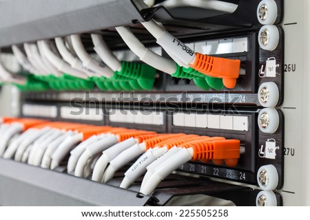 Local area network switch (LAN) ethernet cables on panel board - stock photo