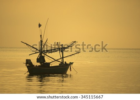 local boat with sunset at Hua Hin, Thailand