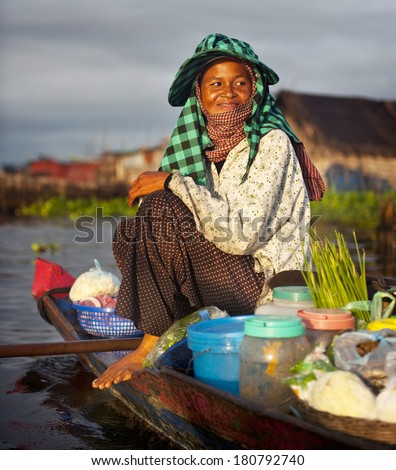 Local Cambodian Seller in Floating Market, Cambodia - stock photo