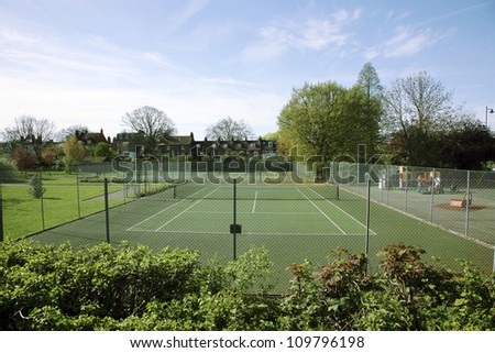Local Community Tennis Court View on a sunny day - stock photo