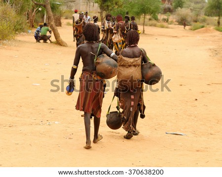 Local Ethiopian people coming back from the market from the Turmi village in the Omo valley in Ethiopia