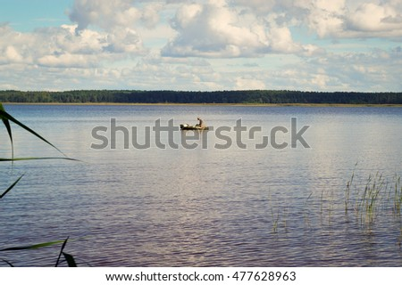 Local fisherman in the middle of the lake