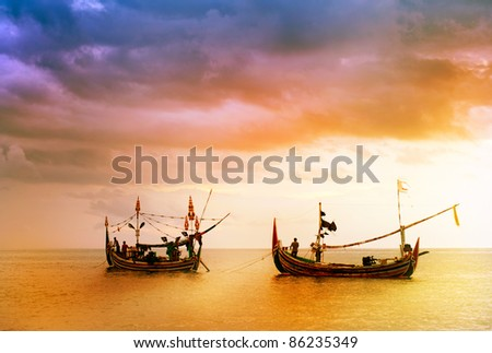 local fishing boat on the beach at sunset time . Bali , Indonesia - stock photo