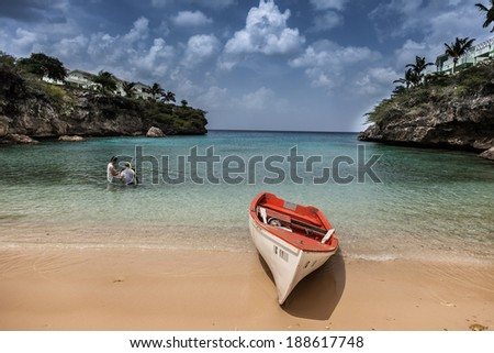 Local Fishing Boats and the beach of  Lagun, Curacao, Caribbean - stock photo
