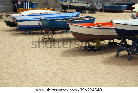 local fishing boats on beach Playa de las Canteras Grand Canary Island Spain Europe       - stock photo
