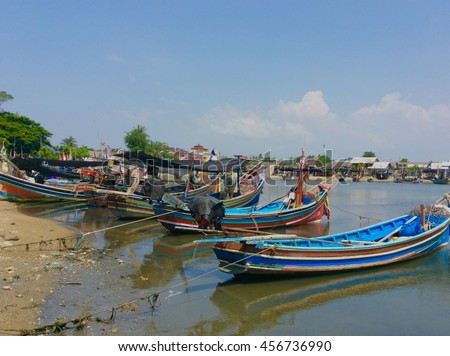 Local fishing boats.Small local tourist boat lies on the sea at . Thailand
