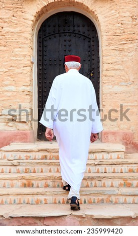 Local inhabitant walking toward his home in Morocco - stock photo