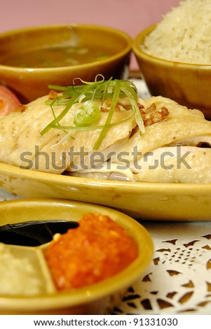 Local Malaysian delicacies, Hainan chicken rice, served with dark soy sauce and chilly, in shallow depth of field - stock photo