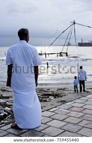 Local man looking to the Chinese fishing nets in Kochi, Kerala, India