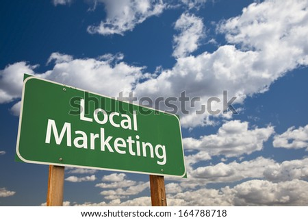 Local Marketing Green Road Sign with Dramatic Sky and Clouds. - stock photo