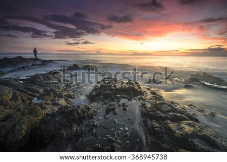 Local people fishing during sunset at Lombok Island, Indonesia - stock photo