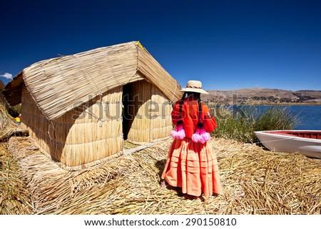 Local people - Peru, Uros floating village, Titikaka lake - stock photo
