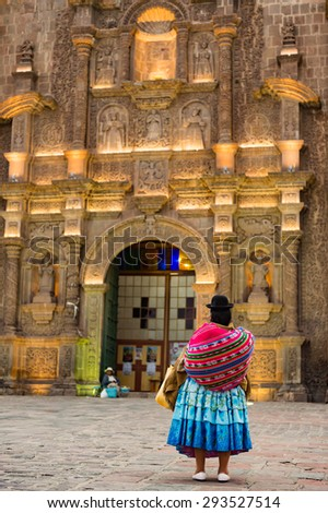 Local peruvian people on front of the Caderal of Puno, Peru - stock photo