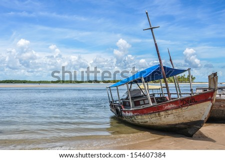Local rustic sailboat at Boipeba and Sao Paulo Island, Bahia, Brazil. South America. Latin America. - stock photo