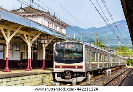 Local train at Nikko train station - Japan, Tochigi Prefecture - stock photo