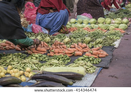 local women selling vegetables at an open market in street of Nepal - stock photo