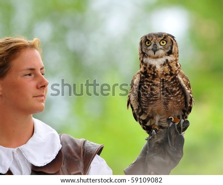 LOCARNO, SWITZERLAND - AUGUST 13: Female falconer holds a spotted owl at the Falconeria demonstration  August 13, 2010 in Locarno Switzerland - stock photo