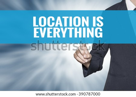 Location is Everything word on virtual screen touch by business woman cyan sky tab - stock photo