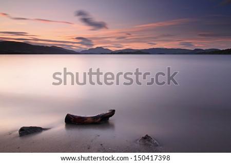 Loch Lomond Sunset with Ben Lomond in the background, Loch Lomond and The Trossachs National Park, Scotland - stock photo