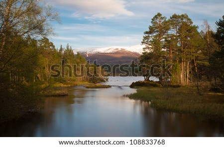 Loch Morlich in the evening sun - Long Exposure version, Cairngorms National Park, Scotland - stock photo