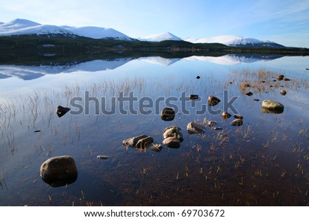Loch Morlich in Winter, in the Scottish highlands. - stock photo