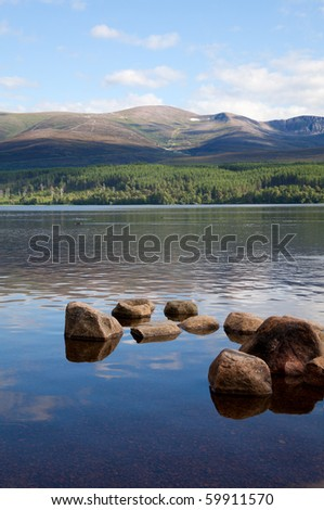 Loch Morlich, Scottish Highlands, with a view on Cairngorm mountain - stock photo