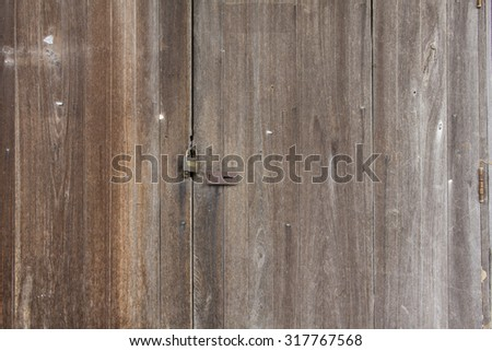 lock a door and Wood building surface and texture.  lock on the door. lock on the door of an old farmhouse - stock photo