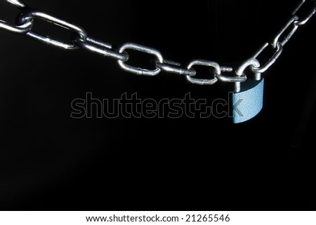 Lock and chain isolated on black background - stock photo
