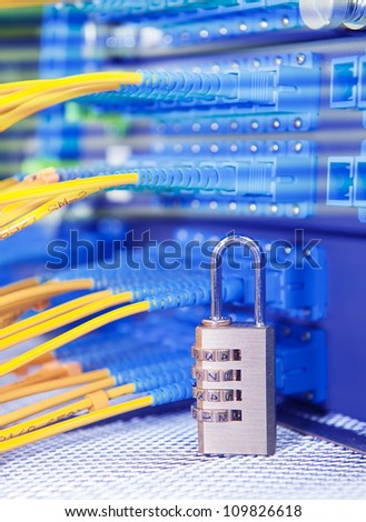 Lock and fiber optical network cable - stock photo
