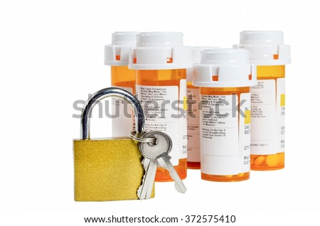 Lock and Keys With Medicine Bottles - stock photo