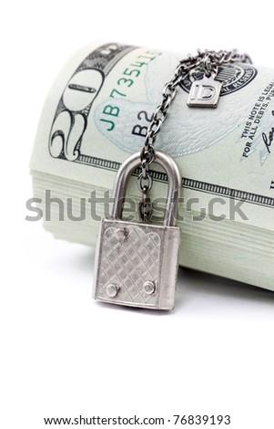 Lock and money isolated on white background - stock photo