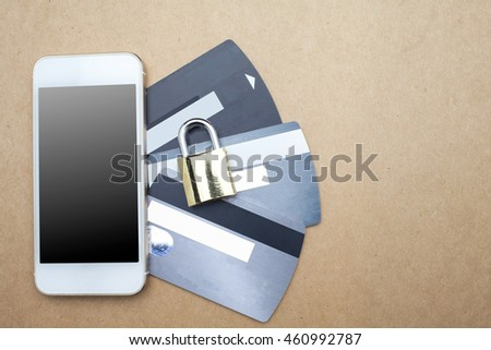 Lock,credit card and mobile on keyboard background