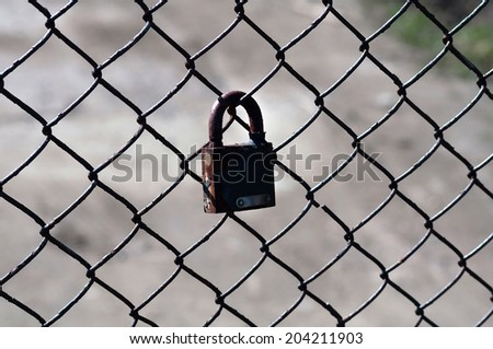 Lock hanging on metal grid