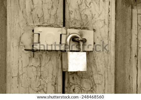 Lock in sepia - stock photo