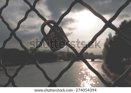 Lock in the bridge, vintage filter - stock photo