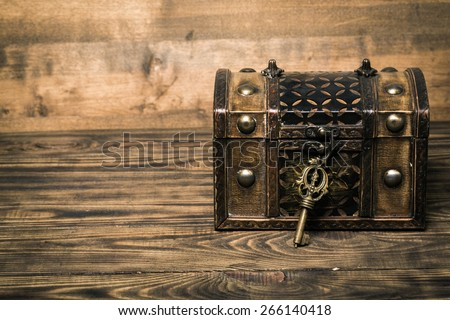 Lock, key, chest. - stock photo