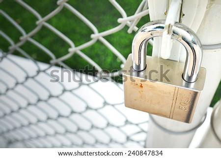Lock Metal door with  net. - stock photo